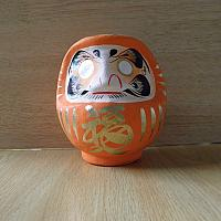 Orange colored Daruma made at Takasaki, Japan: No 1 size
